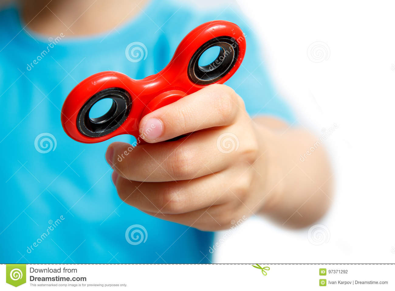 New Spin Toys : Kid hand holding popular fidget spinner toy stock photo