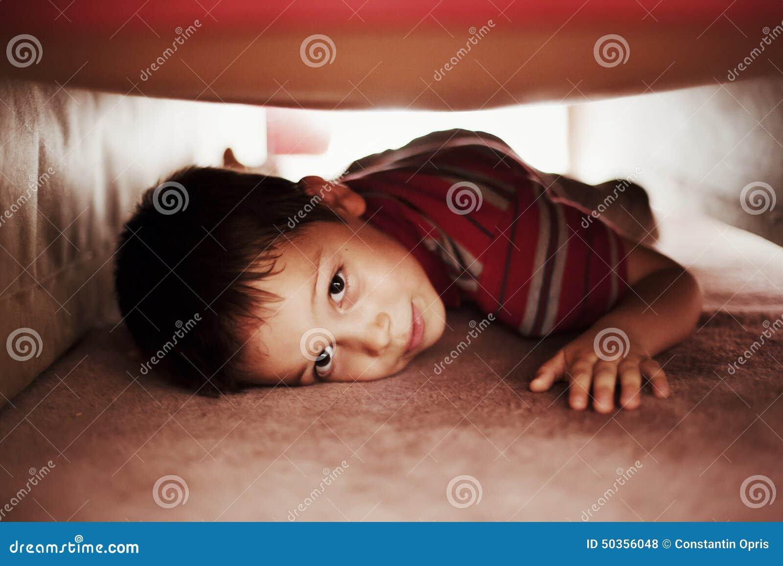 Kid Hiding Under Bed Stock Photo - Image: 50356048