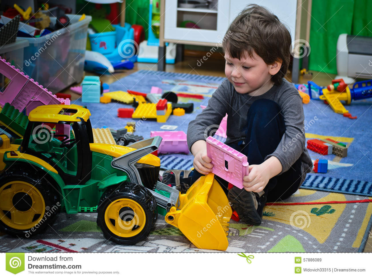 Tractor Toys For Boys : The kid and his toy tractor stock image