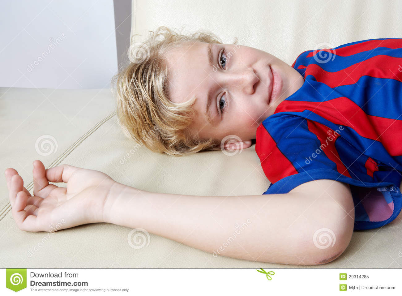 Kid Laying Down Wearing Soccer Team Tshirt Royalty Free