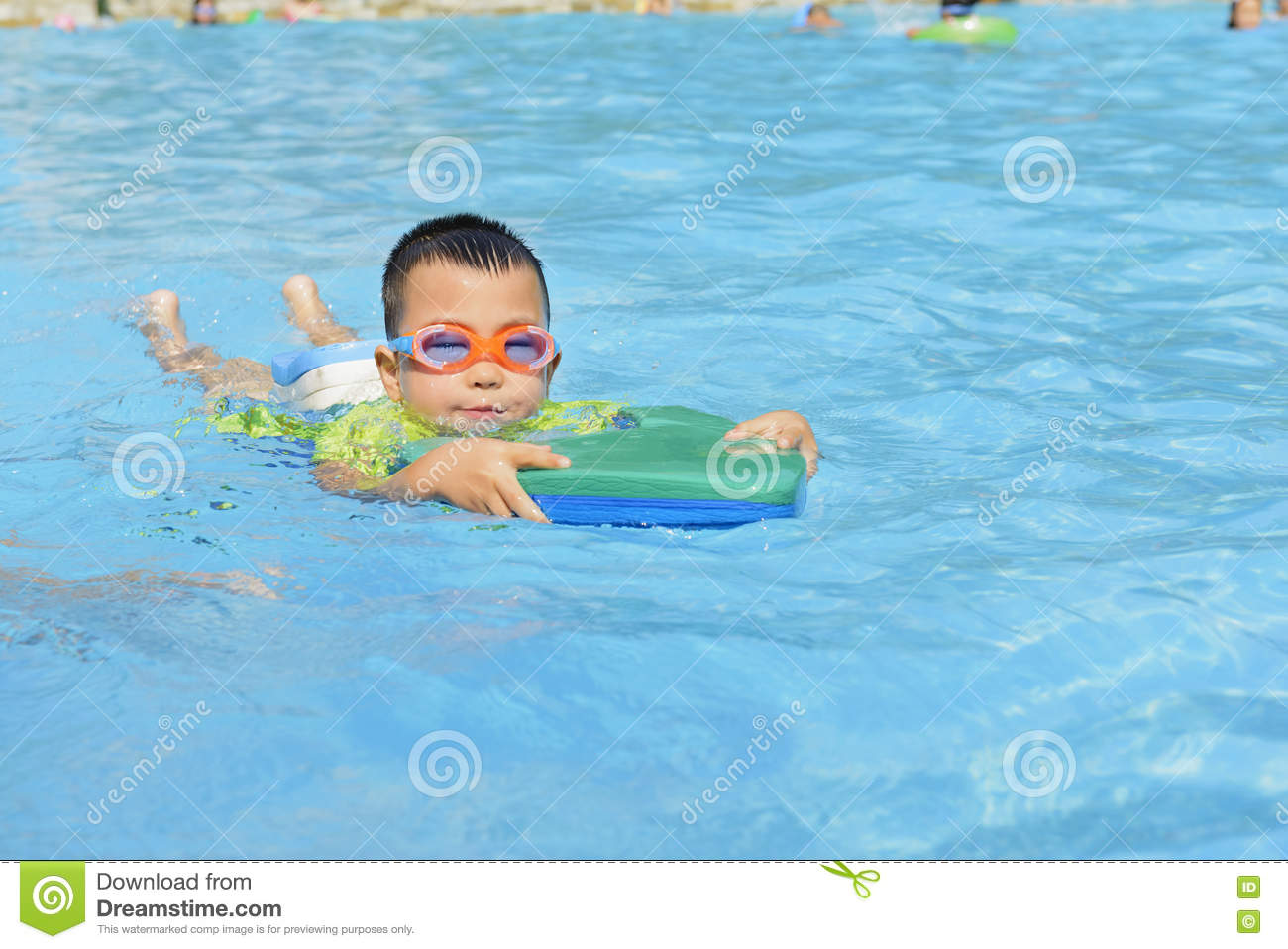 Kid learning to swim in summer