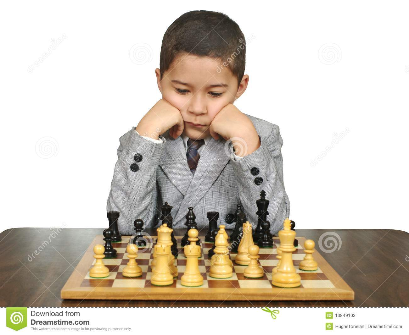Eight-year old boy playing chess, isolated on white background.