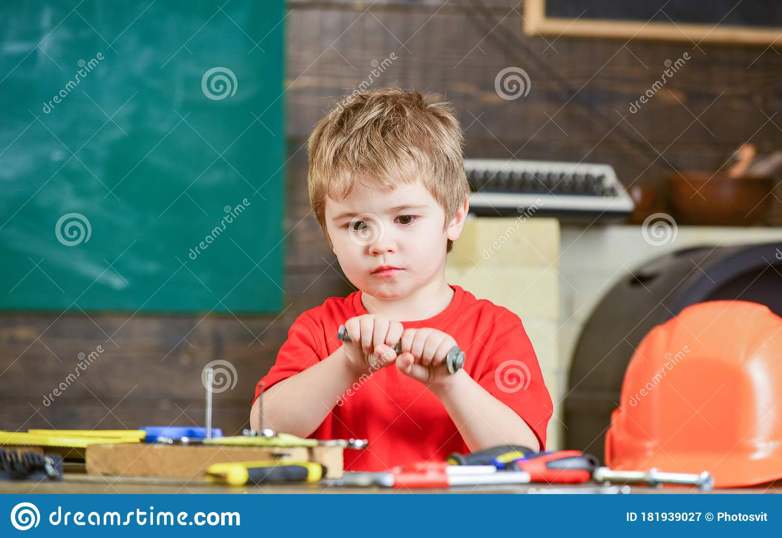 Kid Playing With Long Metal Bolt Concentrated Boy Exploring New Stuff Child In Workshop Stock Image Image Of Carpenter Future 181939027