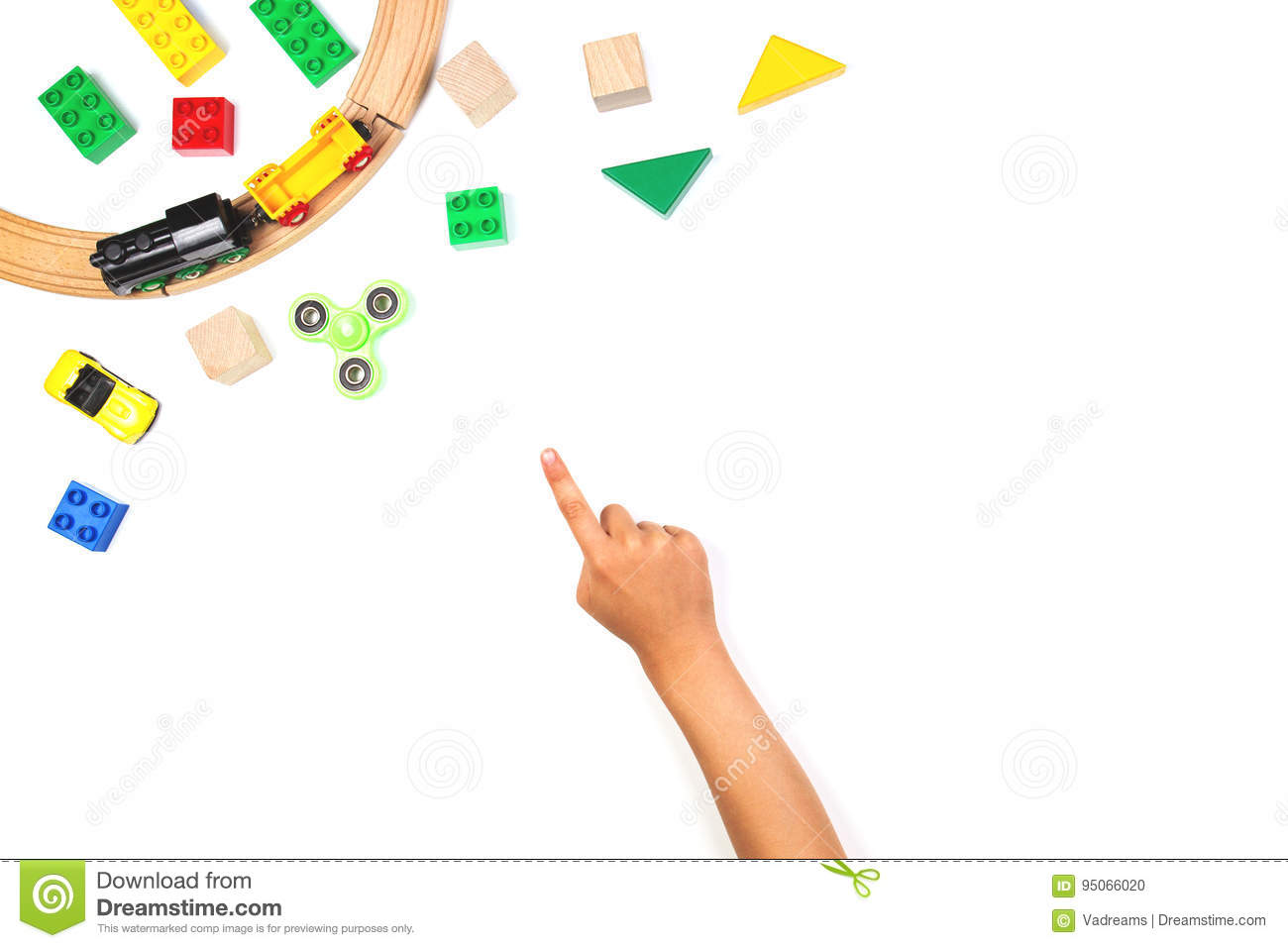 Kid pointing finger to colorful toys. Fidget spinner, cars, toy train, bricks and blocks on white background