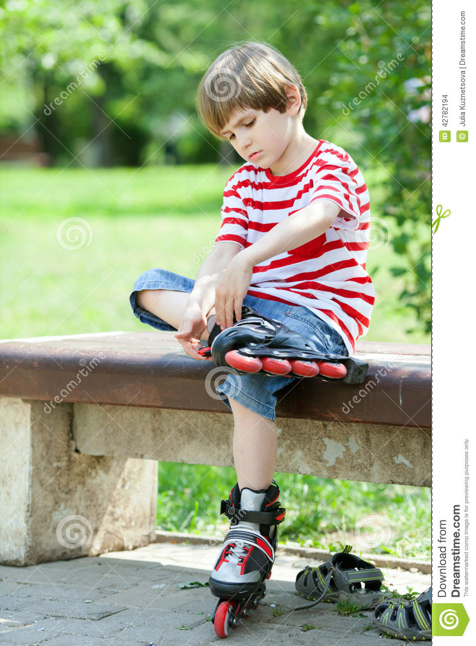 The Kid Put On Roller Skates Stock Photo