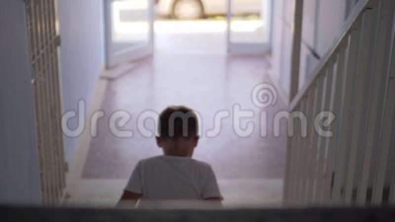 Kid Sitting Alone On The Stairs Stock Footage   Video Of Back, Wait:  109448822