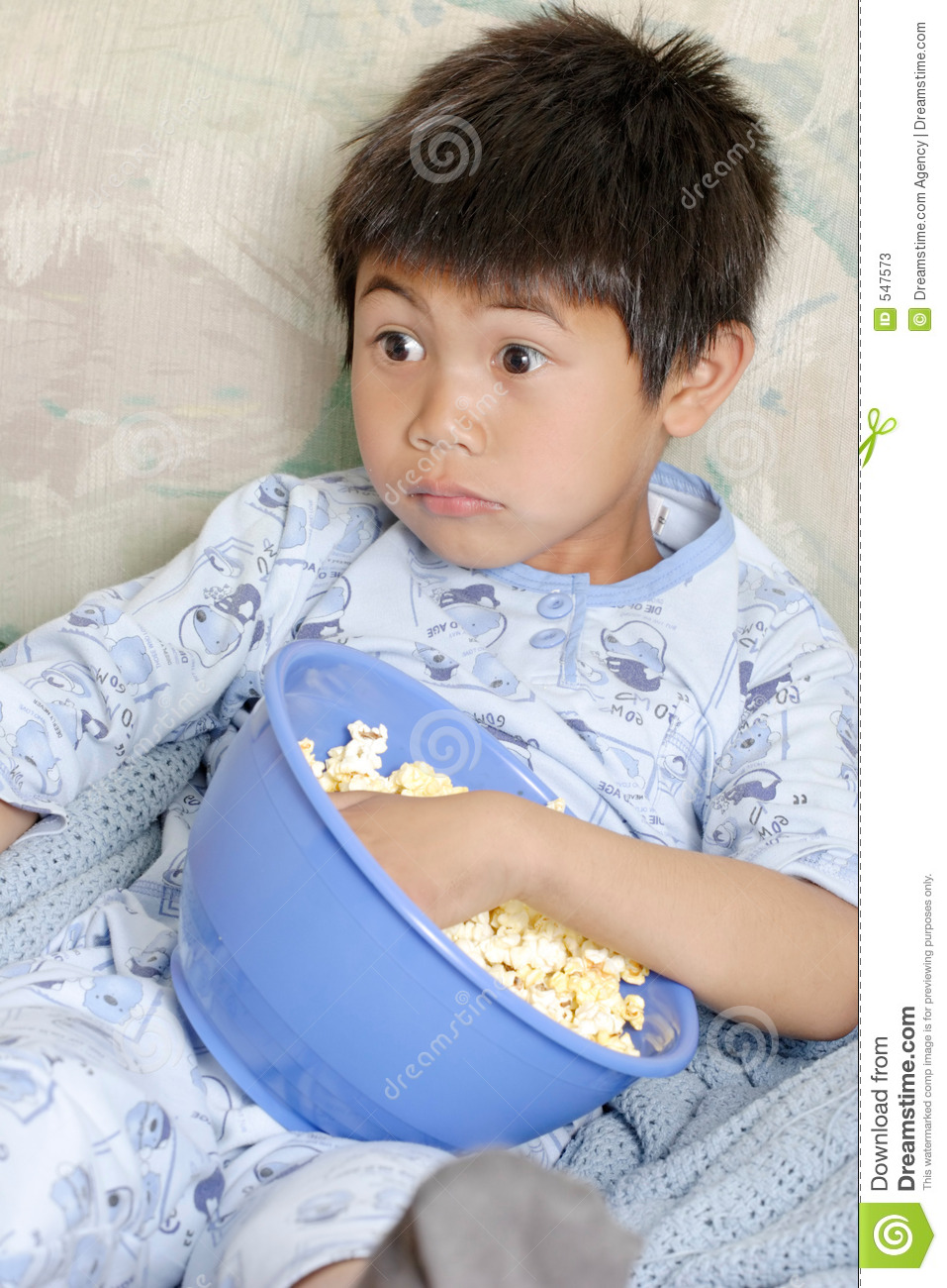 Kid watching a scary movie
