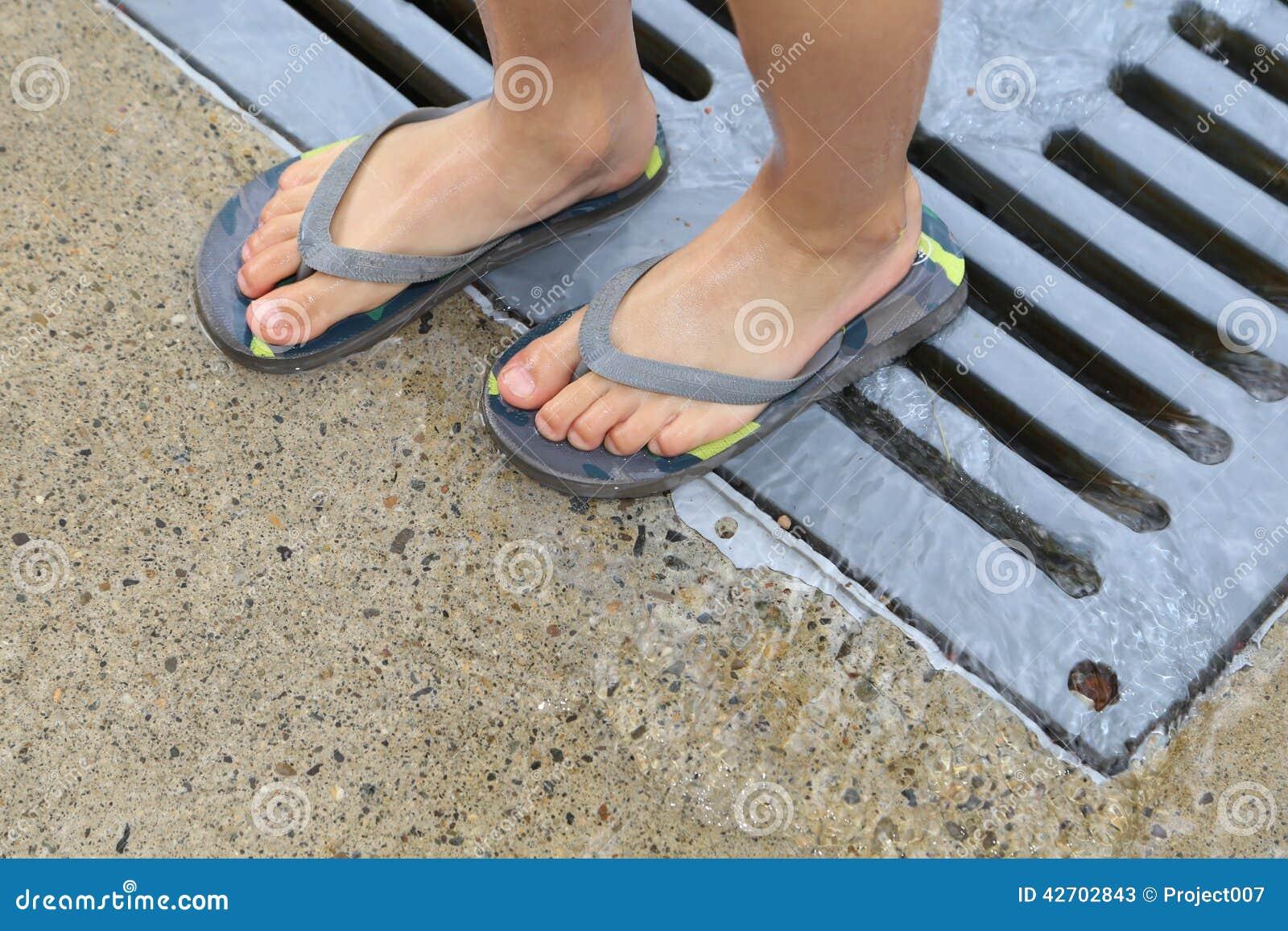 261435cd9 A Kid Wearing Beach Flip Flops Stock Photo 42702843 - Megapixl