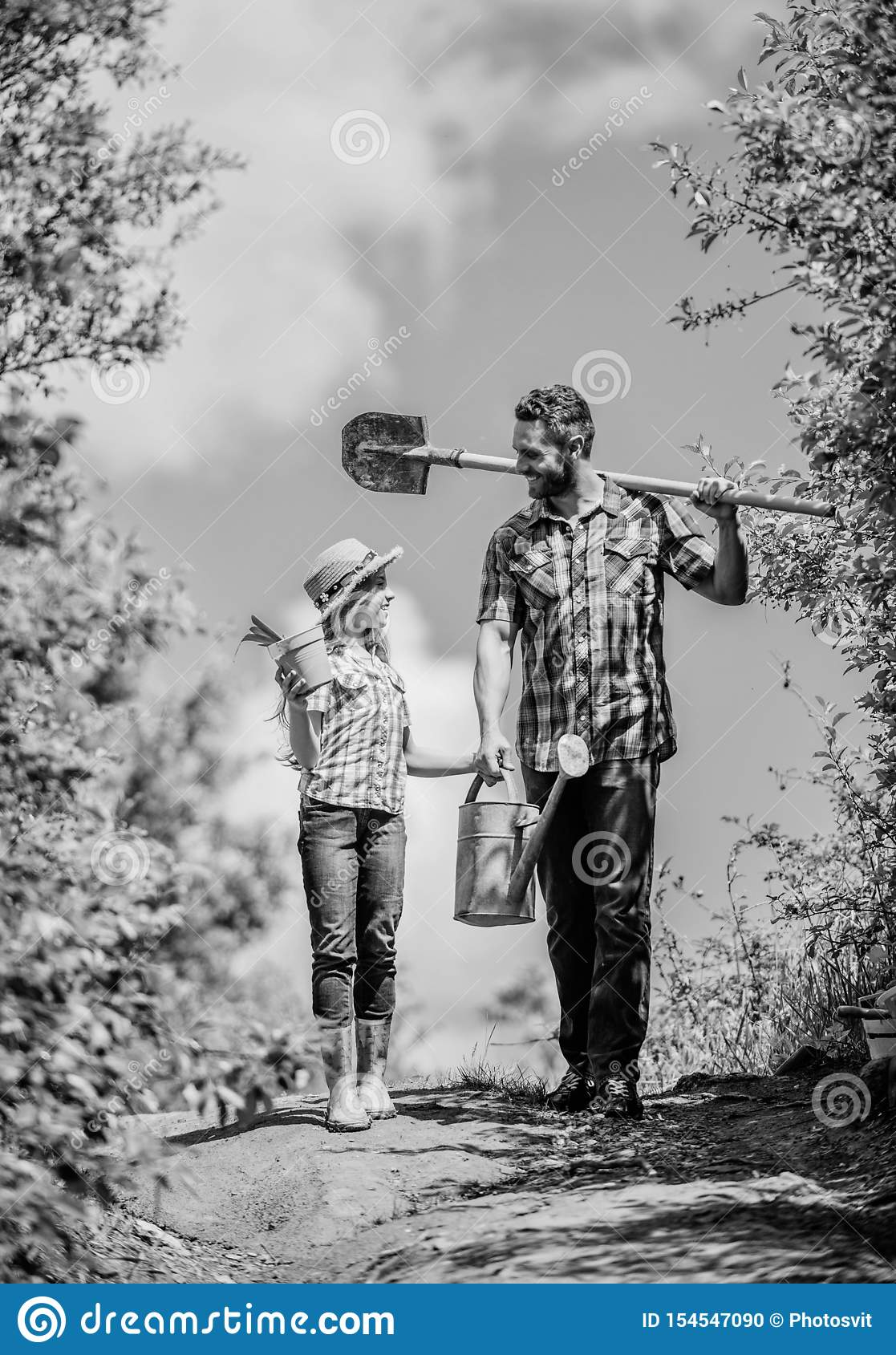 Kid worker with dad hold box. family bonding. spring country side village. father and daughter on rancho. summer farming