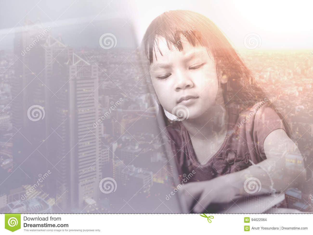 Kid is working laptop with double exposure on city