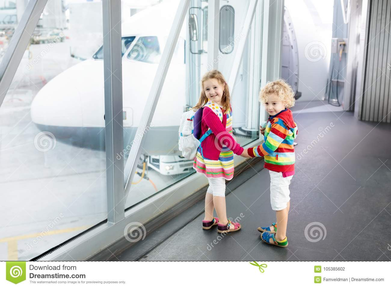 Kids Travel And Fly. Child At Airplane In Airport Stock ...