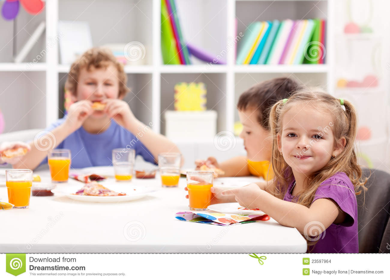 Kids around the table eating stock images image 23597964 for Eating table