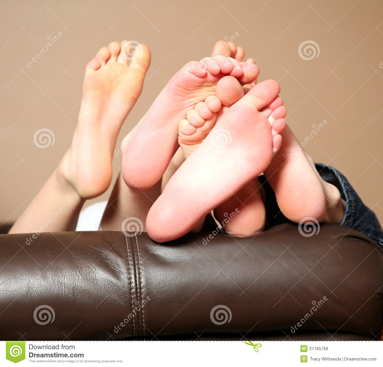 Three pairs of kids feet showing the soles.