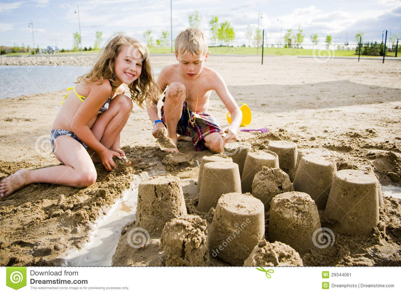 ... playing in the sand building sand castle on a nice summer day
