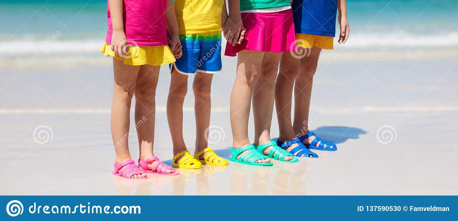 4502fd2b1bf5 Kids beach shoes. Colorful footwear for boy or girl. Group of children  wearing aqua shoe playing on tropical beach on summer vacation. Water and  sand fun.