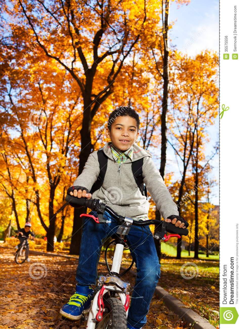 Kids On A Bike In Autumn Park Stock Photo Image Of