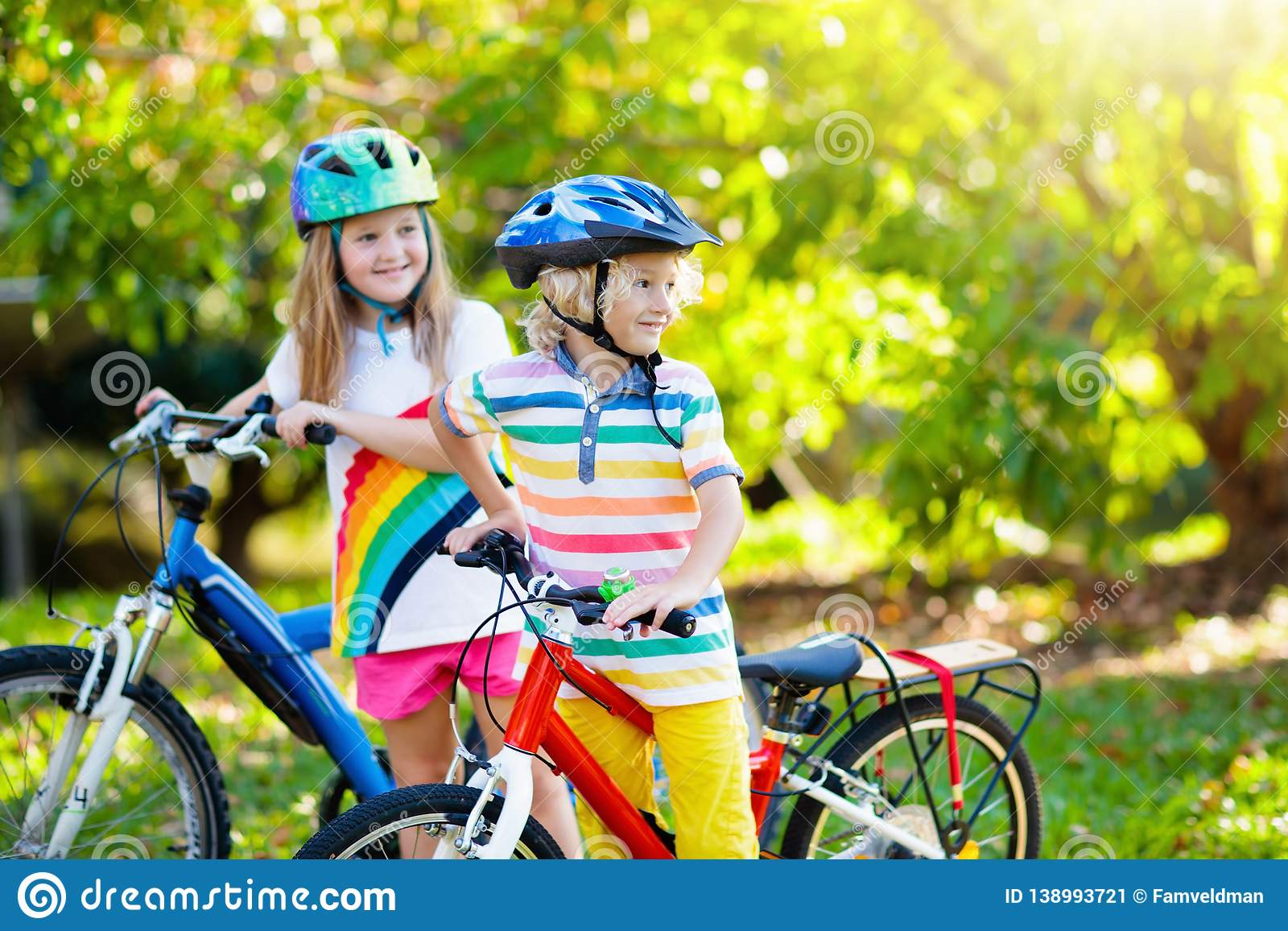 Kids On Bike  Children On Bicycle  Child Biking Stock Image - Image