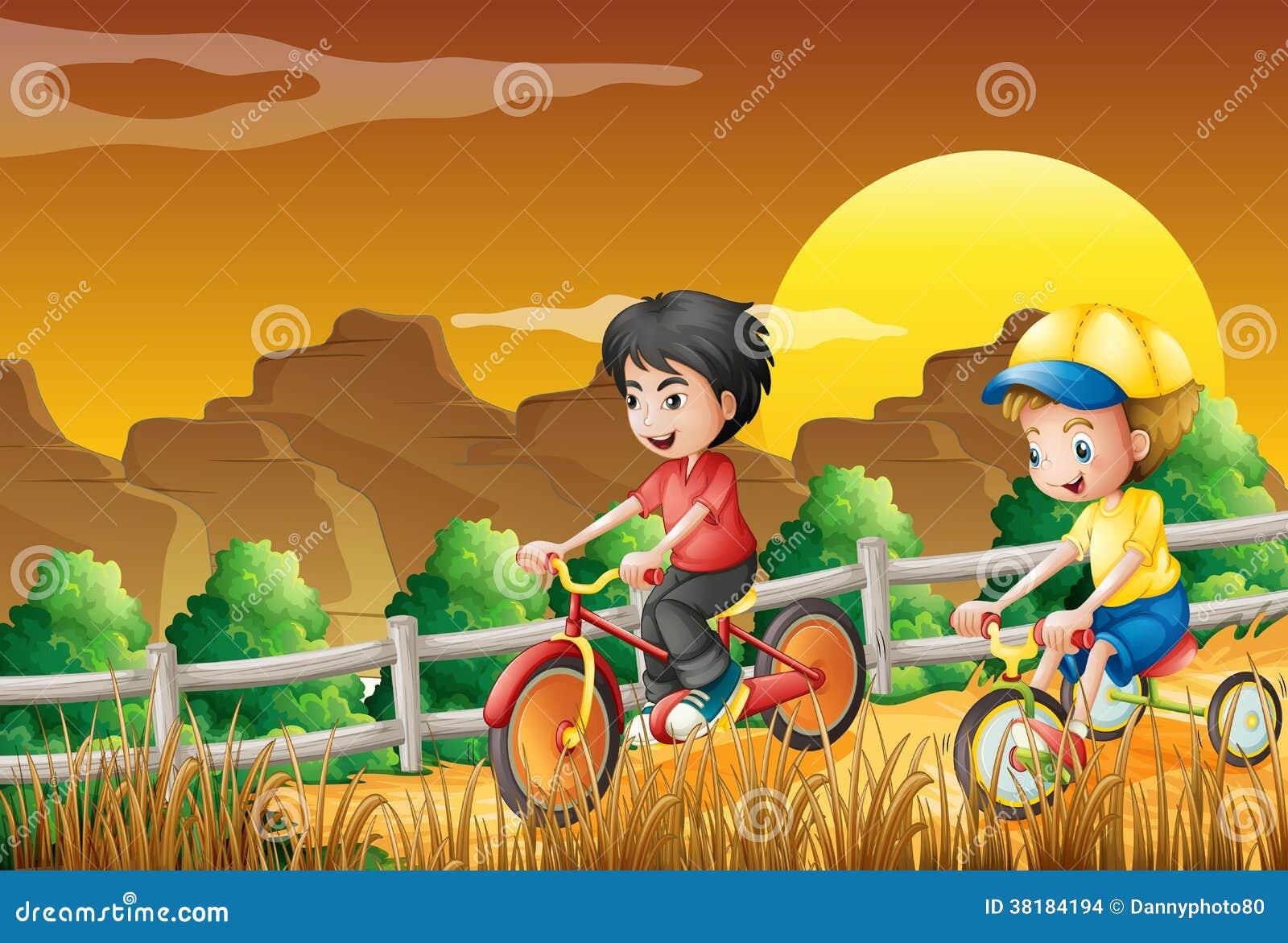 Kids biking at the woods