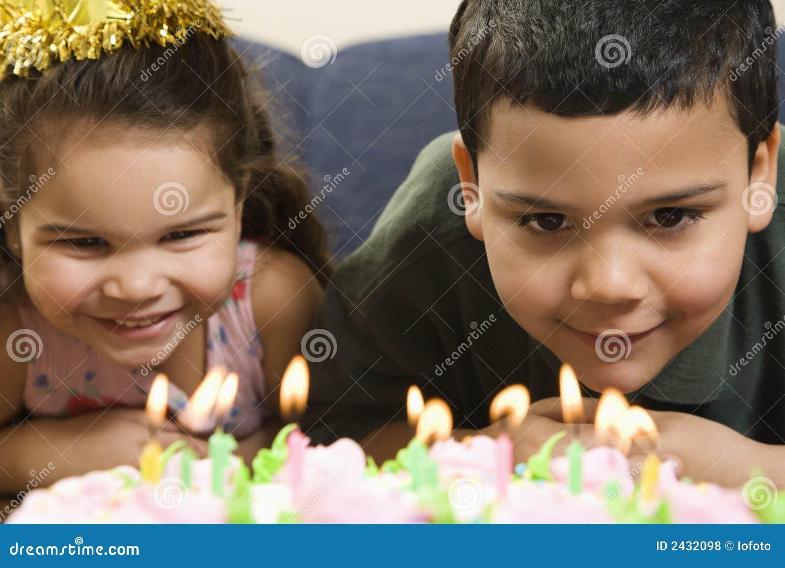 Kids and birthday cake.
