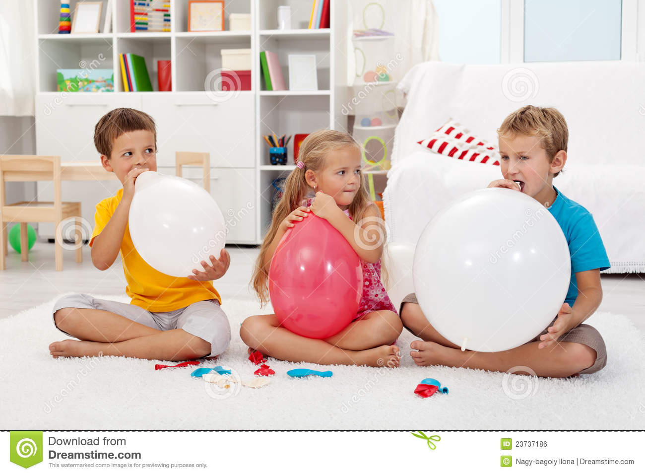 Kids Blowing Up Balloons Royalty Free Stock Image Image