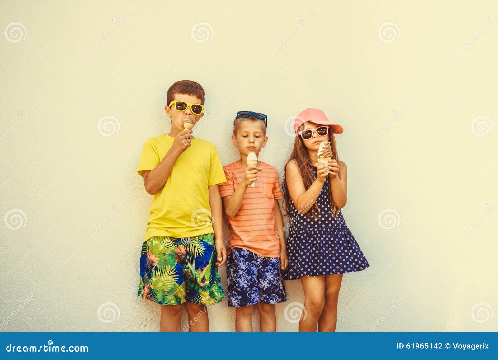 kids boys and little girl eating ice cream stock photo