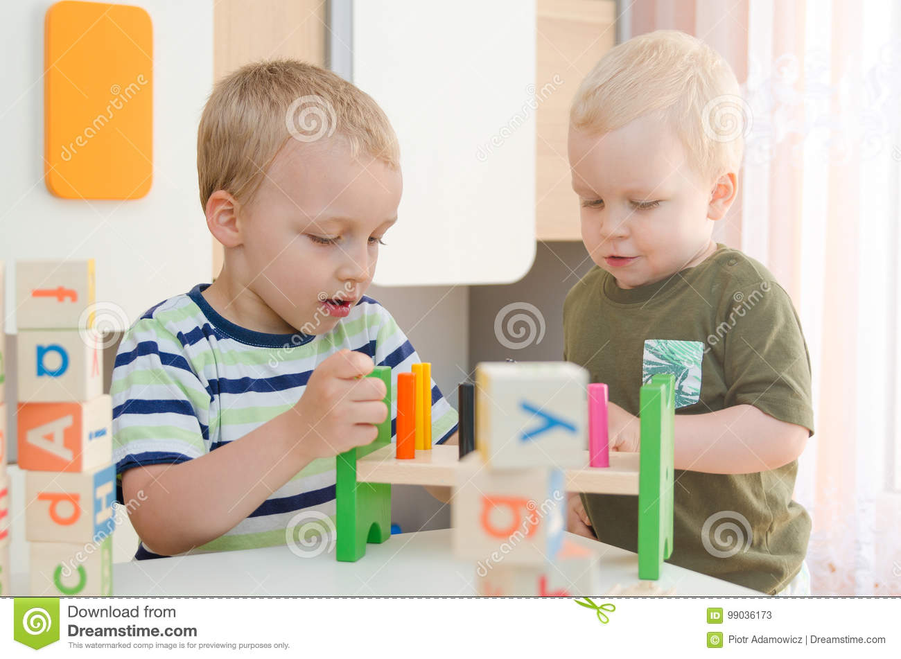 Kids Boys Playing With Toy Blocks At Home Or Kindergarten Stock
