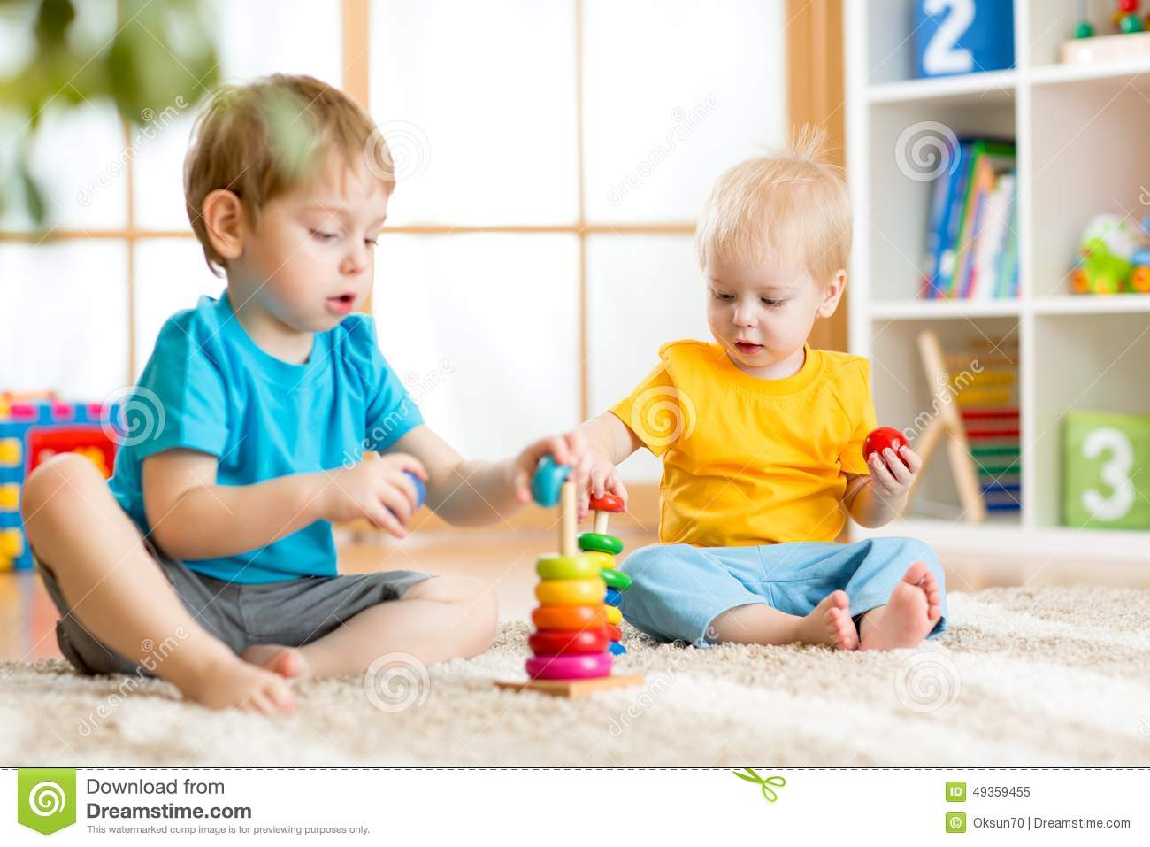 Toddler Toys Photography : Kids boys with toys in playroom stock photo image