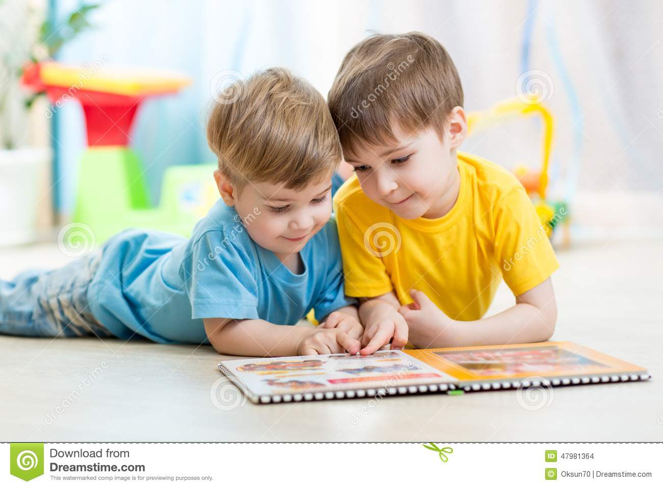 Kids Brothers Read A Book At Home Stock Photo