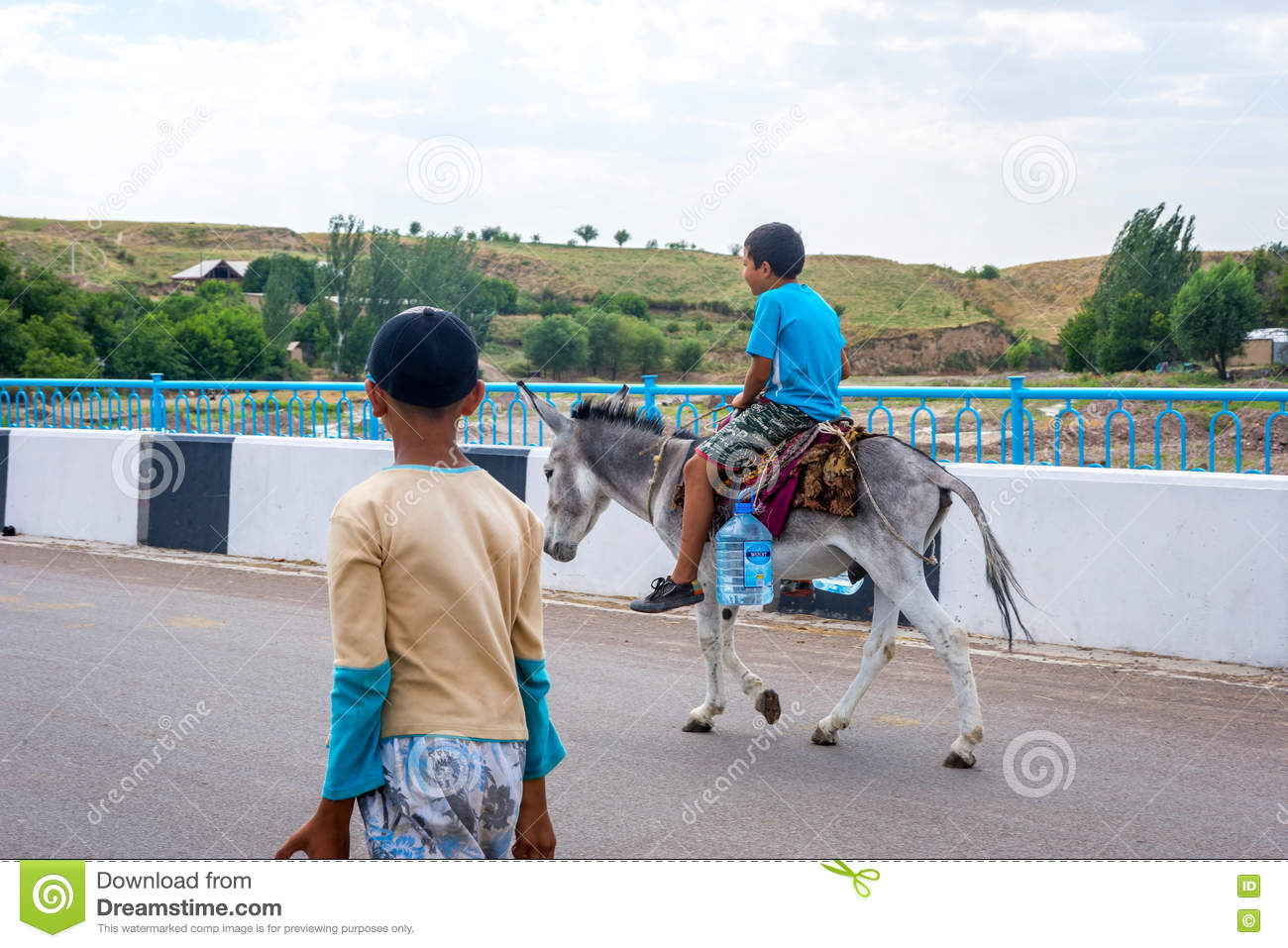 kids-carrying-water-bottles-donkey-turba