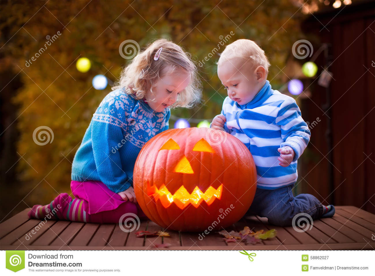 Kids carving pumpkin at halloween stock image of