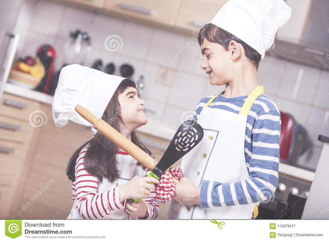 Kids in chef hats in the kitchen