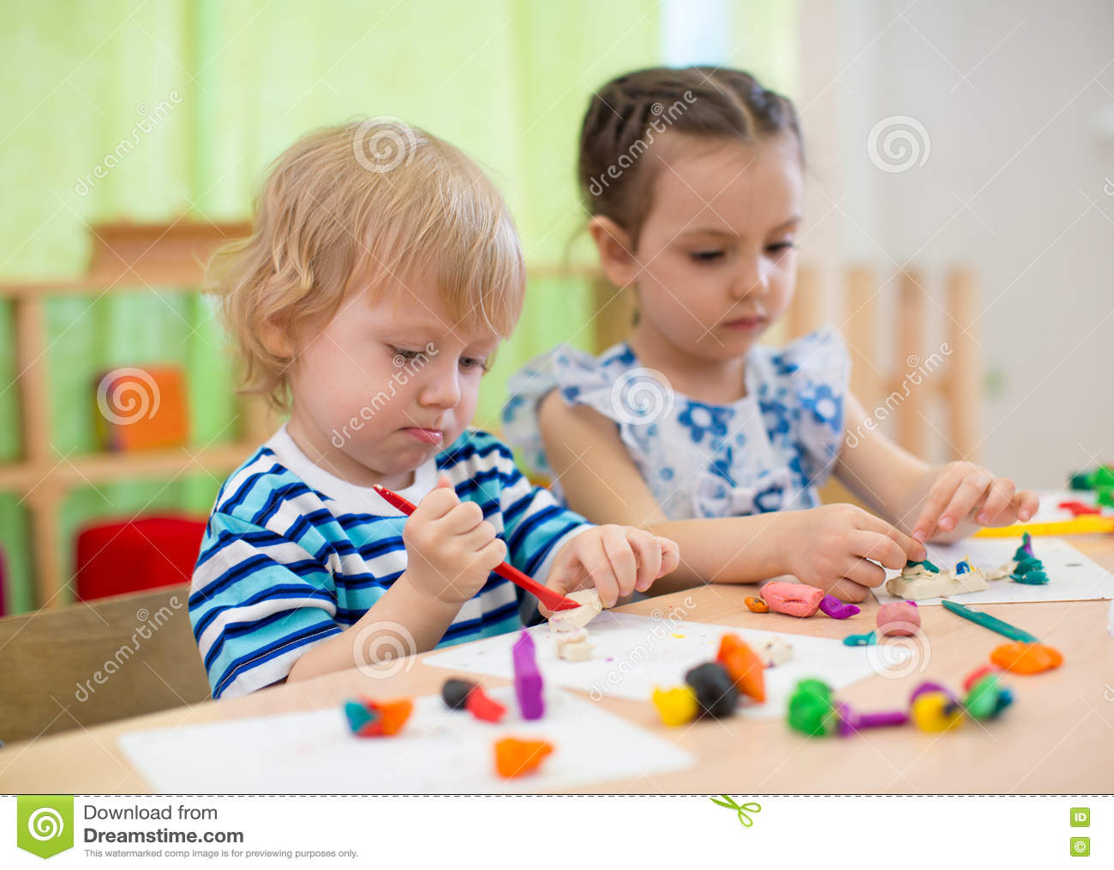 Download Kids Or Children Creating Arts And Crafts In Kindergarten Stock Image