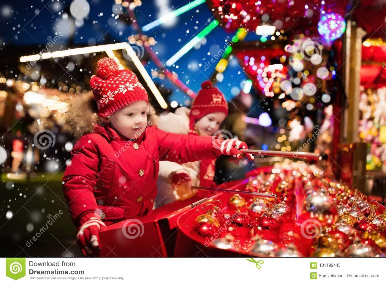 Kids At Christmas Fair. Children Shopping Xmas Gifts. Stock Image ...