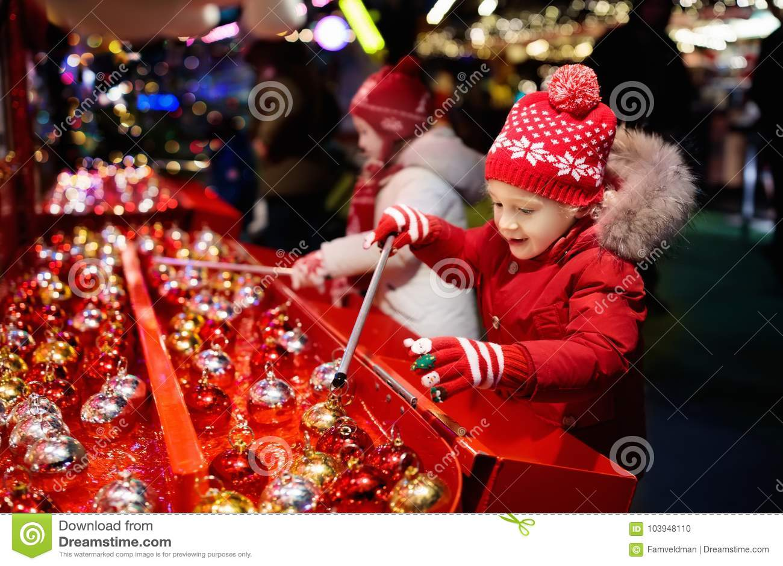 Kids At Christmas Fair. Children Shopping Xmas Gifts. Stock Photo ...