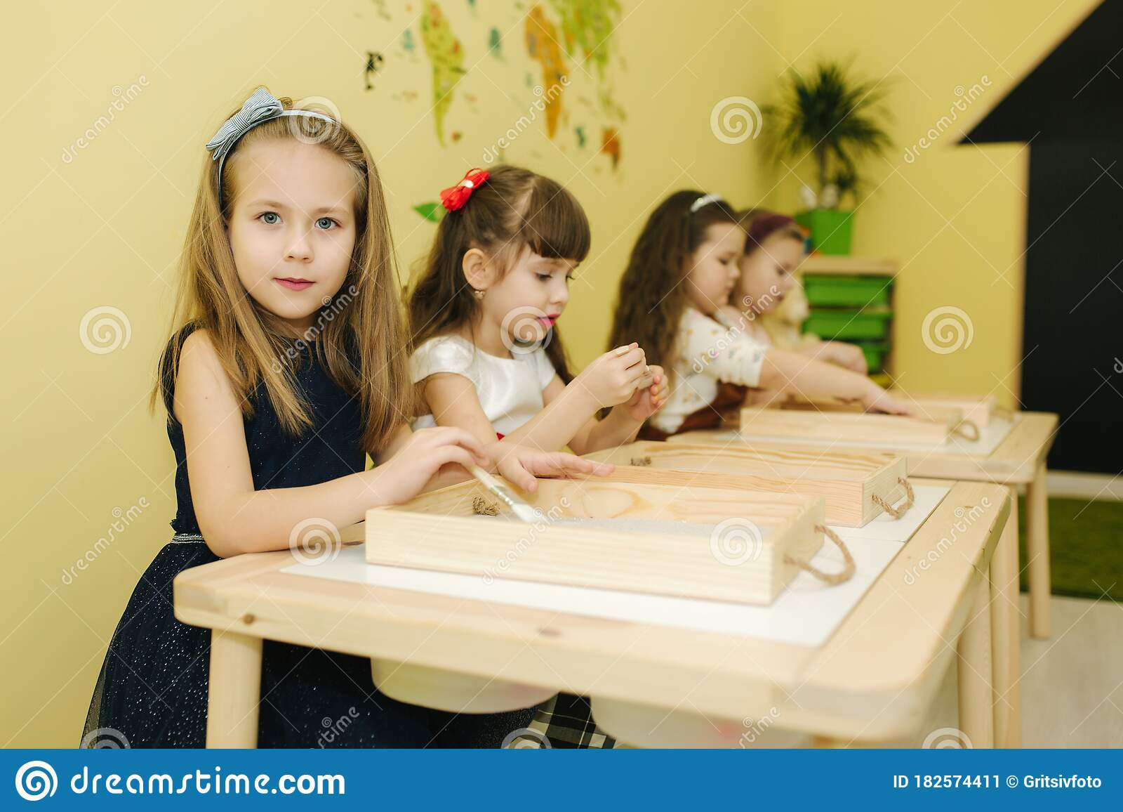Kids In Class Create Drawing By Sand. Children Use Tassel For Rawing.  Preschool Stock Image - Image of creative, education: 182574411