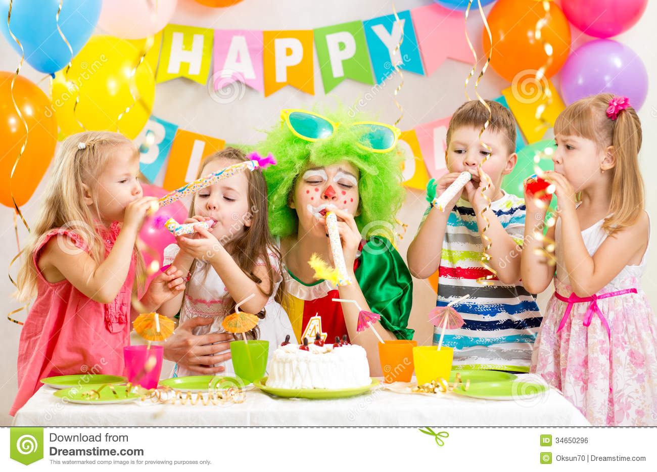 Kids And Clown Celebrate Birthday Party Royalty Free Stock