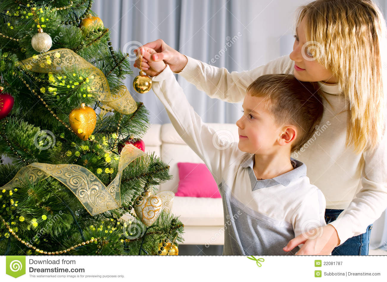Kids Decorating A Christmas Tree Royalty Free Stock