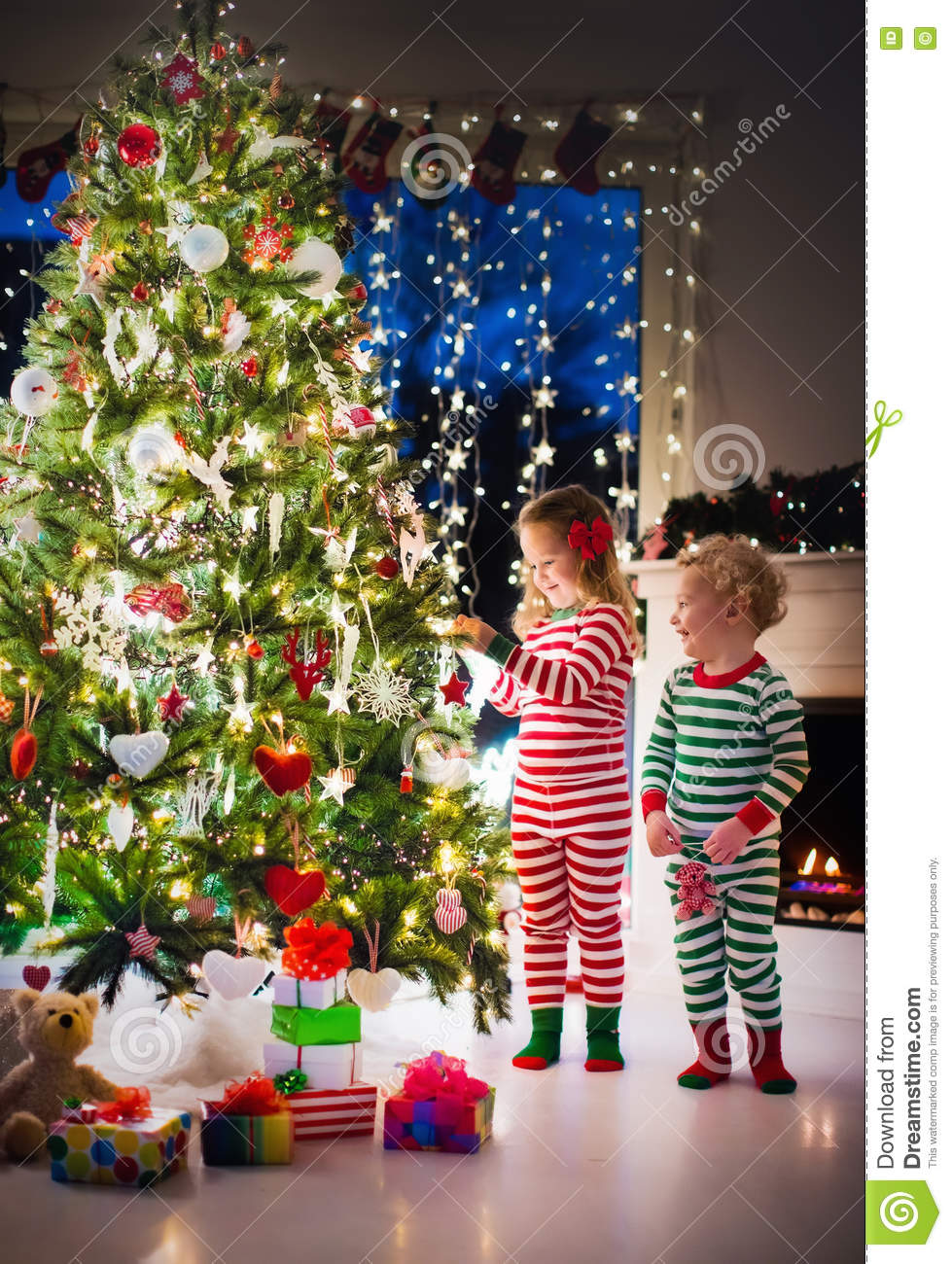 Kids Decorating Christmas Tree Stock Image Image of green