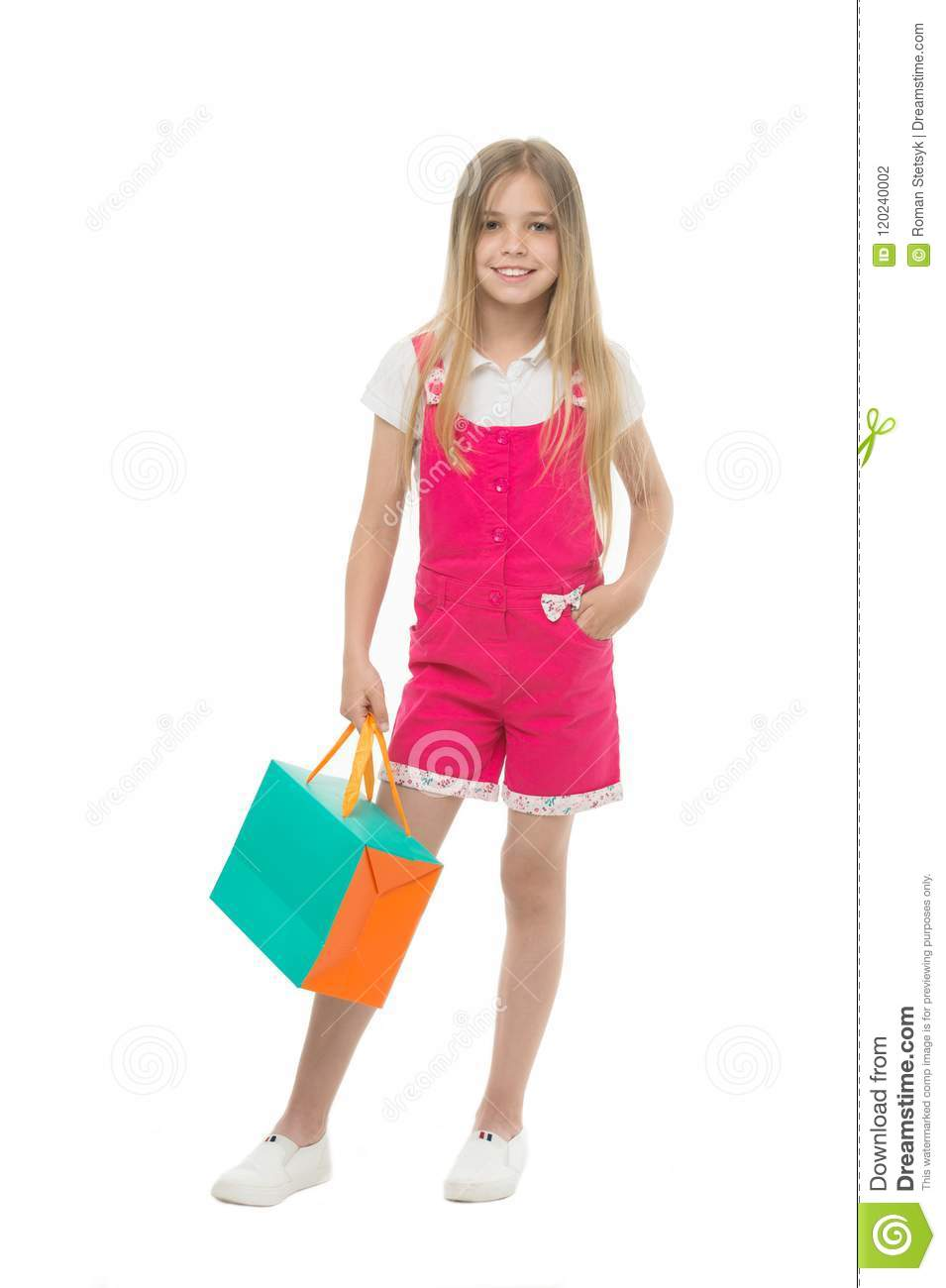 6faa11146e79 Kids designer clothing summer sale. Girl cute teenager carries shopping  bag. Kid bought clothing