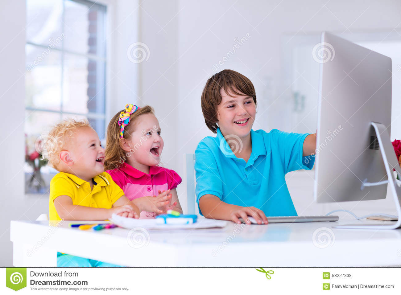 Modern Classroom Kids ~ Kids doing homework with modern computer stock photo