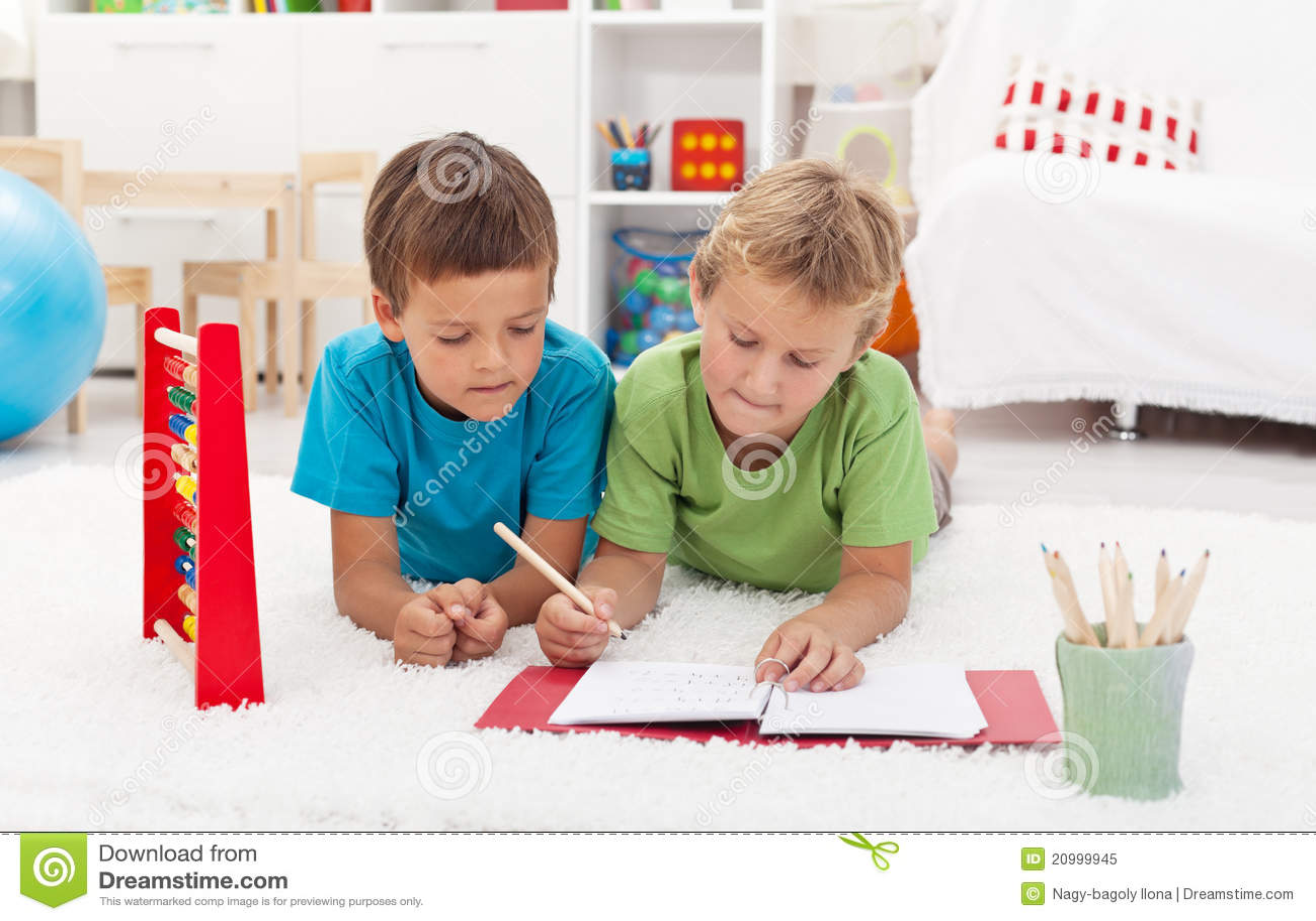kids doing math exercises on the floor stock image