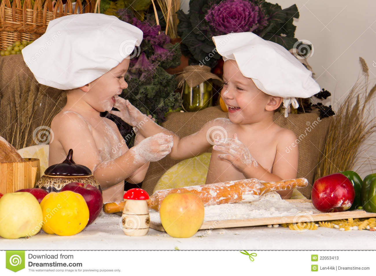 Kids dressed as chefs cooking