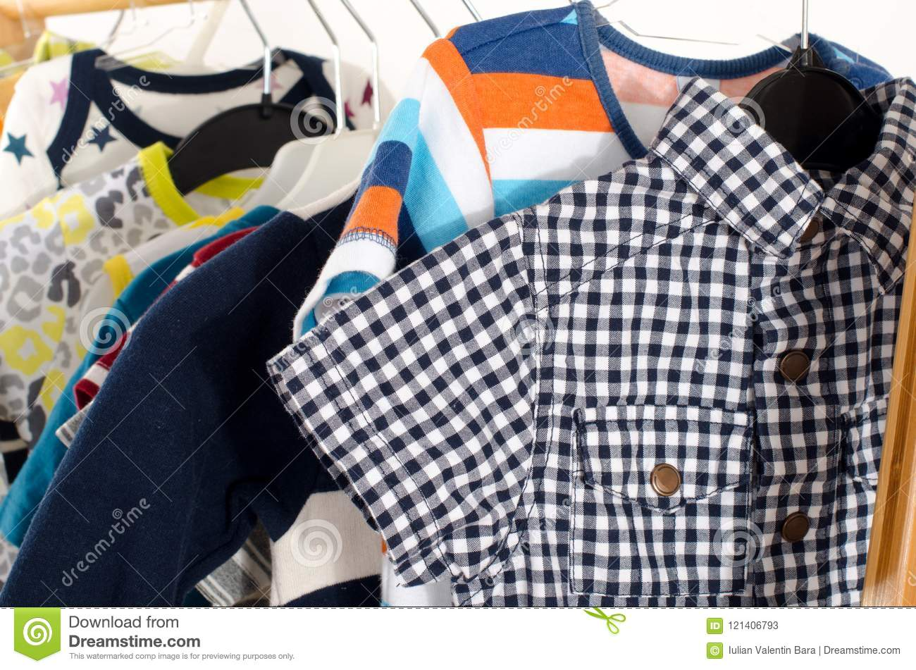 0c6634ca5 Kids Dressing Closet With Clothes Arranged On Hangers. Stock Image ...