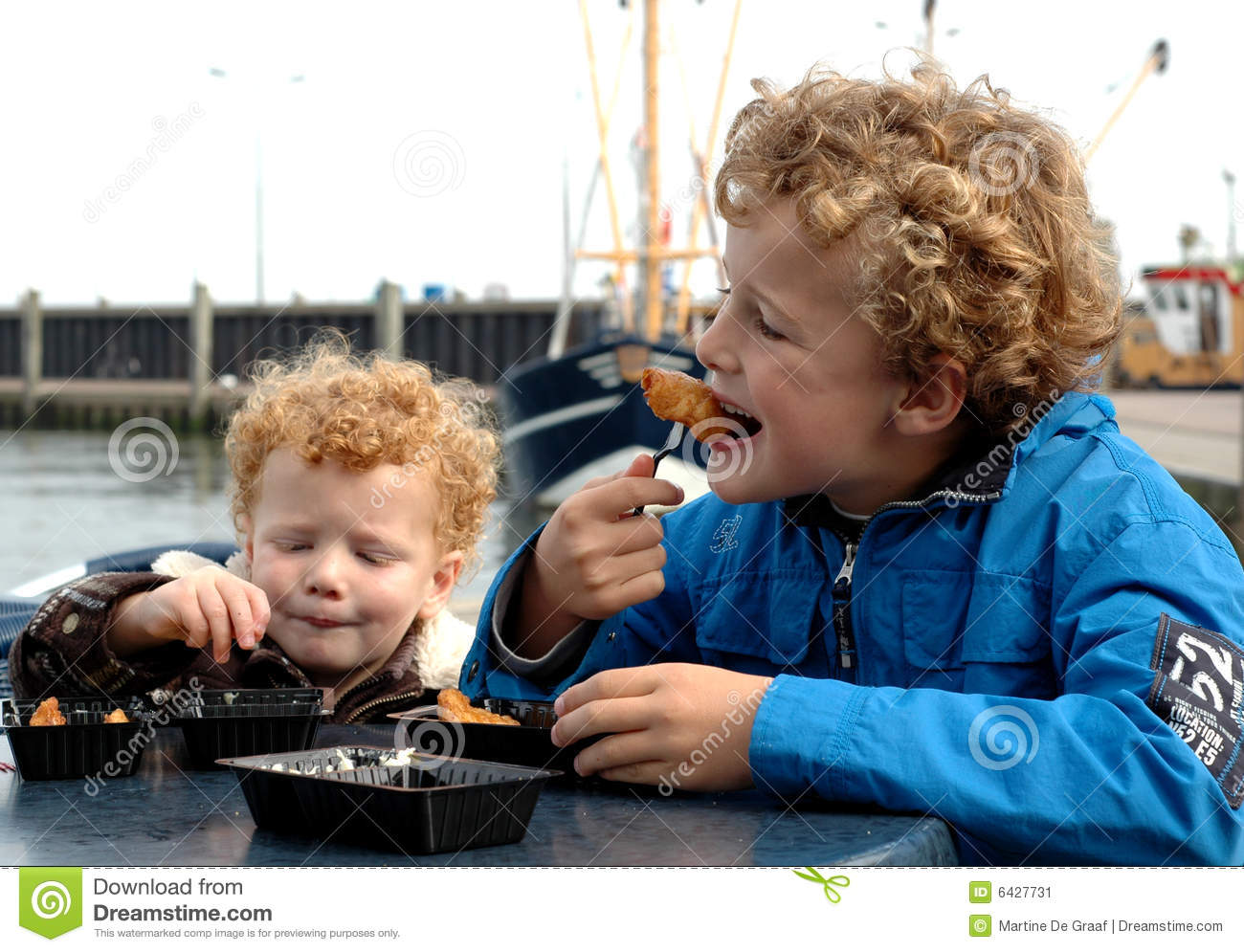 Kids eating fish stock image image 6427731 for Dreaming of eating fish