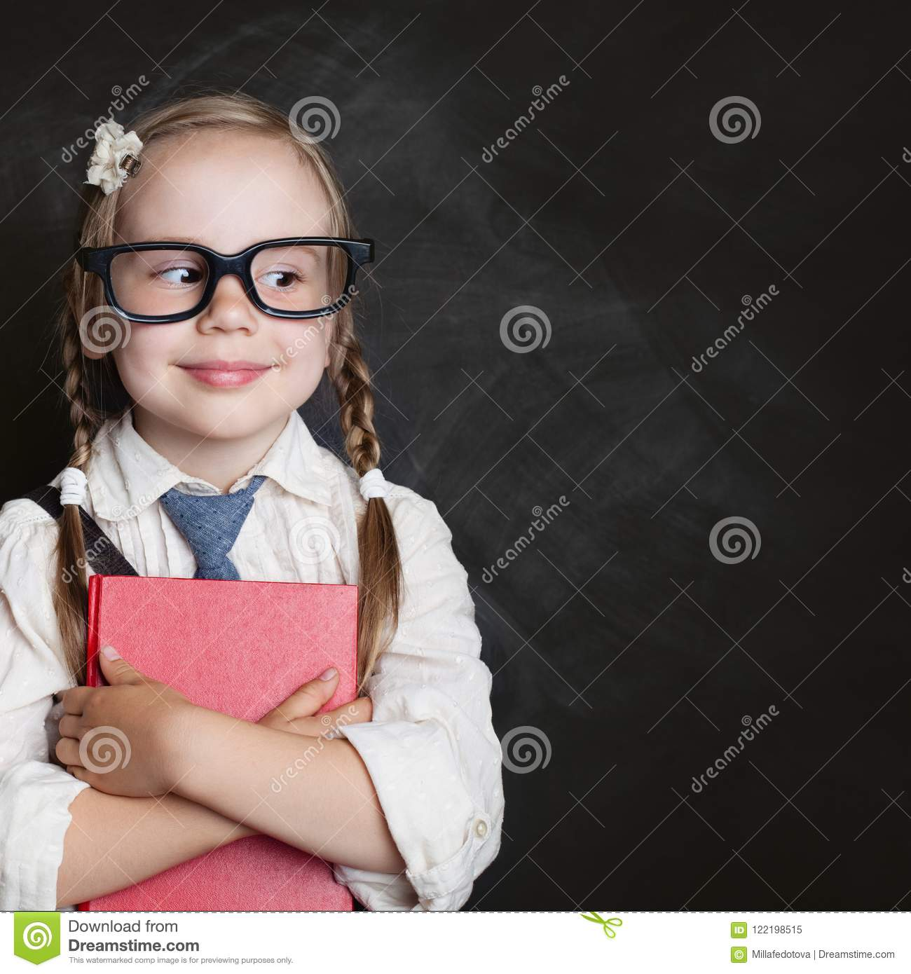 Kids education and child reading concept. Cute child girl