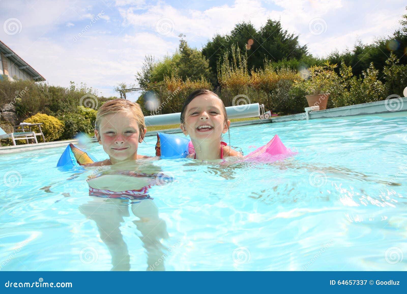 Kids Enjoying Swimming Pool Stock Photo - Image: 64657337