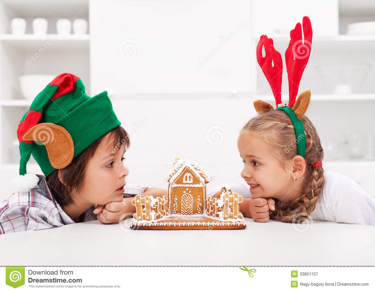 Kids With Funny Christmas Hats And Gingerbread House Stock ...