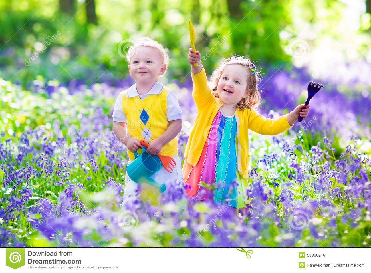 Kids in a garden with bluebell flowers stock photo image for Un jardin de fleurs
