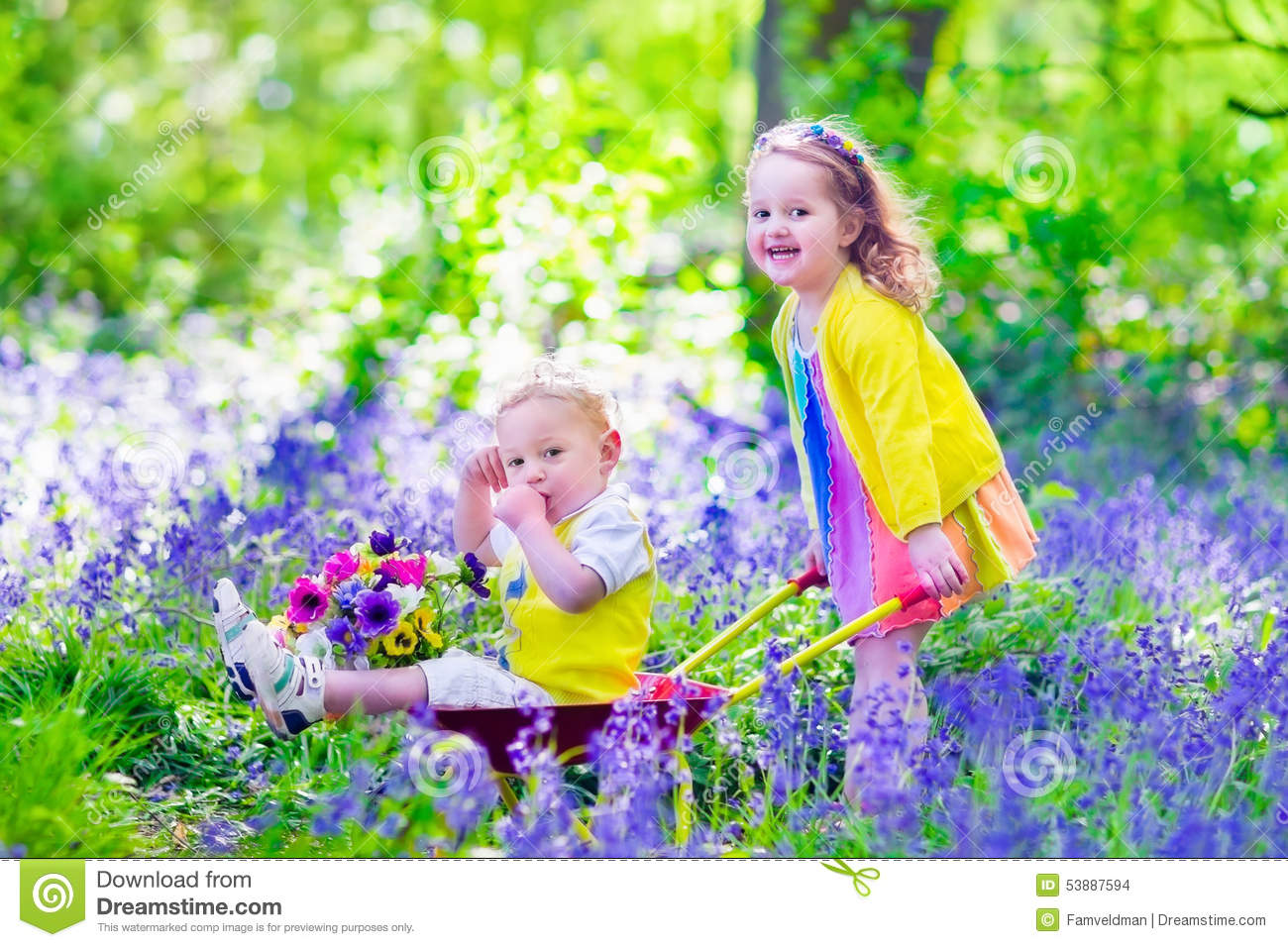 Kids in a garden with bluebell flowers stock photo image for Gardening with children
