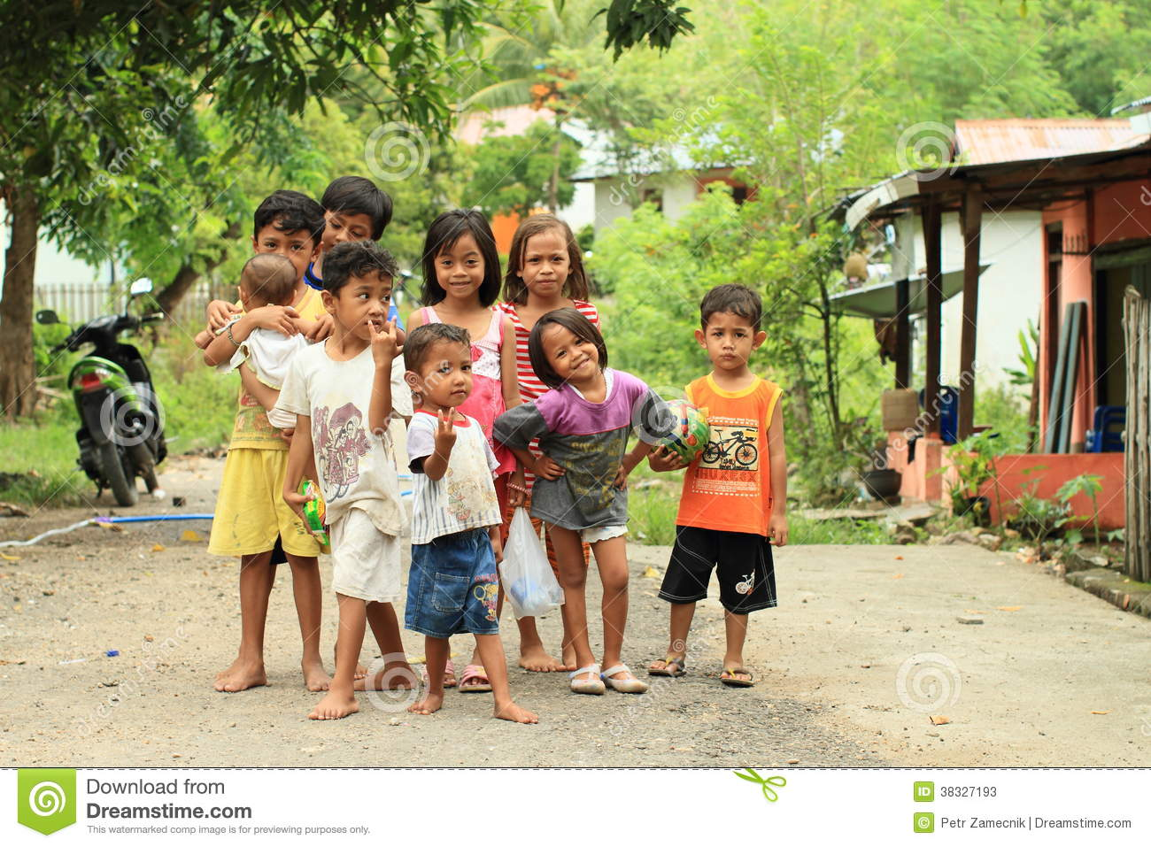 Barefooted kids - girls and boys posing on street of Labuan Bajo
